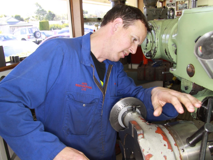 Simon Steffens machining a bespoke part in the Auto Engineering Shop at Auto Restorations.