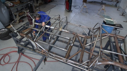 "Andy Wylie checks the fit and finish of the bespoke space frame of a 1953 Barchetta recreation ""kit"" car, in the Custom Coachwork Shop at Auto Restorations."
