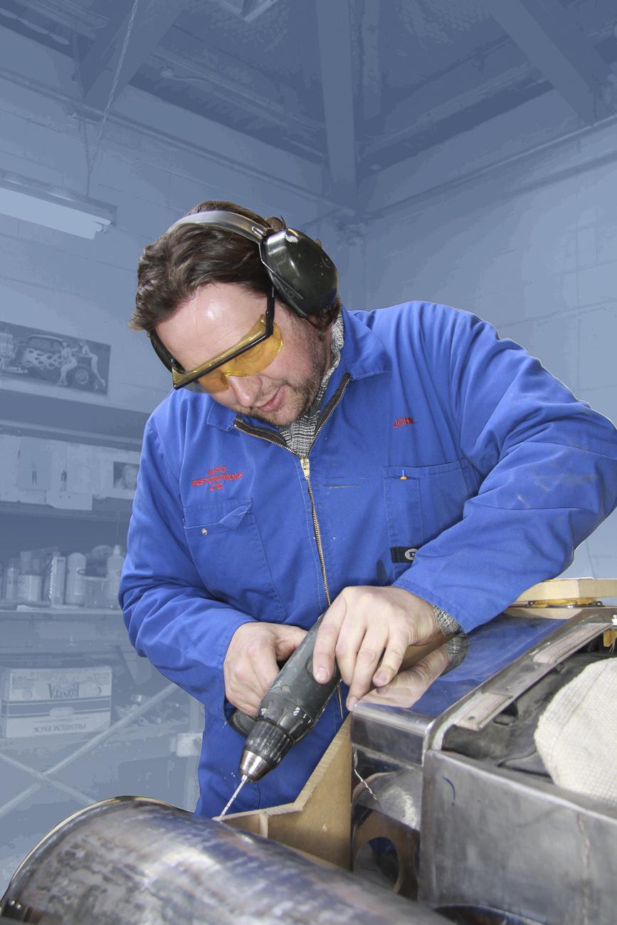 John Scott, working on the front guard of a classic Rolls Royce restoration, Panel Shop, Auto Restorations.