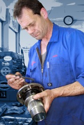 Mark Saint Merat hand finishes a bespoke engine part in the Mechanical Workshop at Auto Restorations.