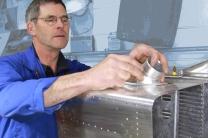 Robin Willan fabricating a bespoke radiator for a WWII warbird aircraft restoration. Radiator Shop, Auto Restorations.