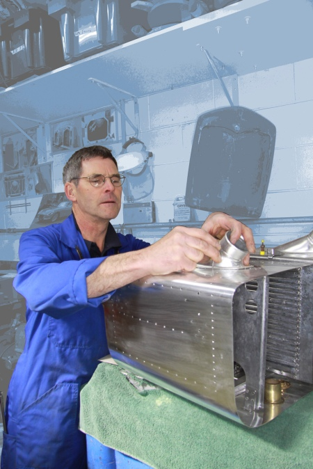 Robin Willan fabricating a bespoke radiator for a WWII warbird aircraft restoration. Radiator Shop, Auto Restorations.