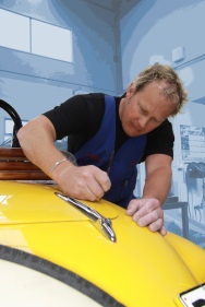 Shane Faulkner putting the finishing touches on the paint job of a complete Delage restoration, Paint Shop, Auto Restorations.