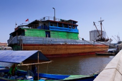 Lambo or lamba type of Pinisi line up at Sunda Kelapa, old harbour of Batavia, now Jakarta. Pinisi are a traditional Indonesian two to three-masted sailing ship akin to a cutter.