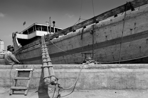 A typical wooden cargo boat gangplank. These magnificent Makassar schooners called Pinisi are an important means of transporting goods to and from the outer islands of Indonesia.