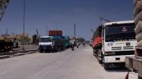 Freight trucks lined up at the port of Sunda Kelapa, Jakarta, Indonesia.