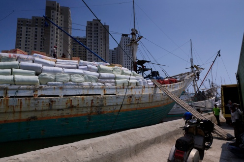 A lamba type of motorised Pinisi named Citra Bahagia laden with cargo at the old port of Sunda Kelapa, Jakarta, Indonesia.