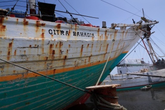 The prow of lamba type of motorised Pinisi named Citra Bahagia the old port of Sunda Kelapa, Jakarta, Indonesia.
