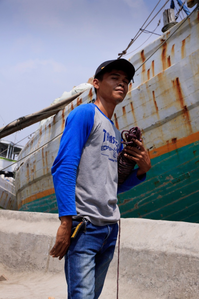 Coolie poses for a portrait on the wharf at the old port of Sunda Kelapa, Jakarta, Indonesia.