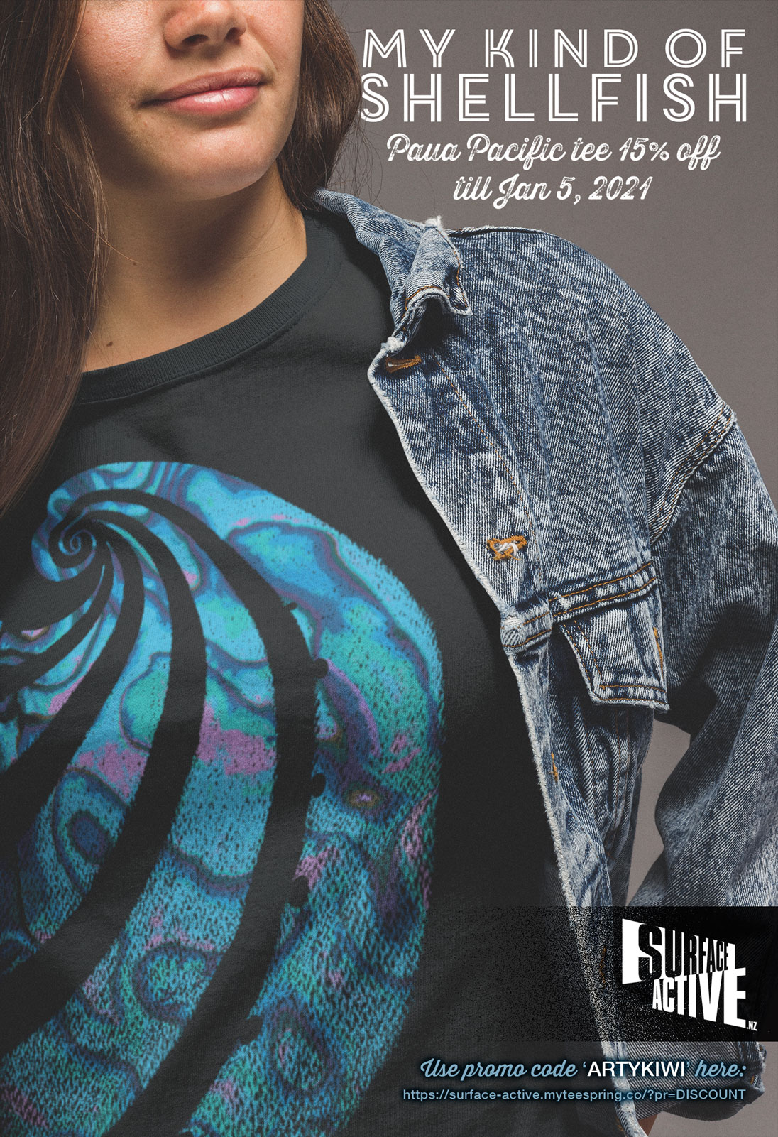 My kind of shellfish. Paua Pacific tee 15% off till Jan 5, 2021. Promotional Facebook Ad for Surface Active New Zealand Artwear T-shirts. Young woman wearing a black paua teeshirt underneath her blue denim jacket.