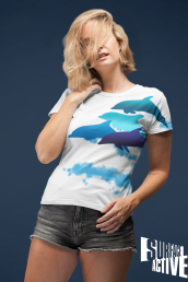 A woman wearing a leaping dolphin all over print white teeshirt