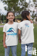 Front and back view of twin girls wearing dolphin t-shirts at a park.