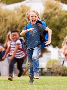 a-cheerful-boy-running-in-a-weta-New-Zealand-t-shirt