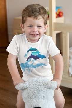 A dolphins leaping New Zealand onesie on a baby boy playing in his room.