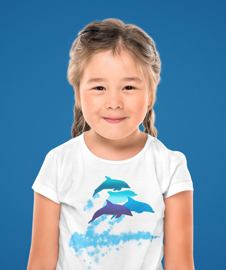 A little girl wearing a dolphins leaping New Zealand t-shirt at a studio.