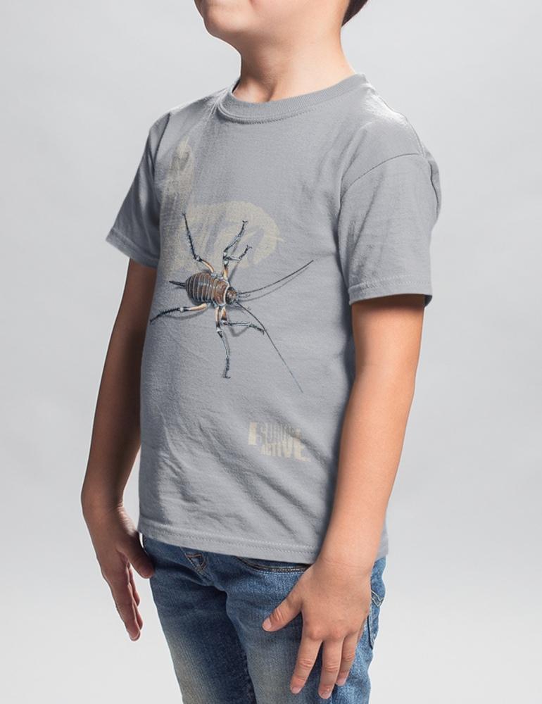 A boy standing in a studio wearing light grey weta, New Zealand t-shirt.