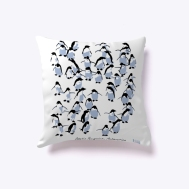 The front of a white indoor cushion featuring the front view of the Adelie penguins Antarctica design.
